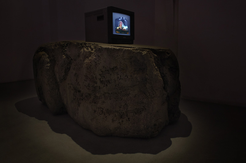 The Grawling Saffron of the Unicom Consort of Satyr Mountain, 2007-2009, Edition of 5, Spray enamel, acrylic paint, Birch Plywood, 2 lb. Bead Foam, 2 part expanding Foam. Elastomeric Urethane coating, PVC pipe, monitor, DVD player, video with sound, 60 min,111,25x 104,14 x 182,88 cm  